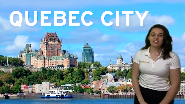 Brightspark Tour Leader Tamara stands in front of a photo of Quebec City Skyline on a virtual tour