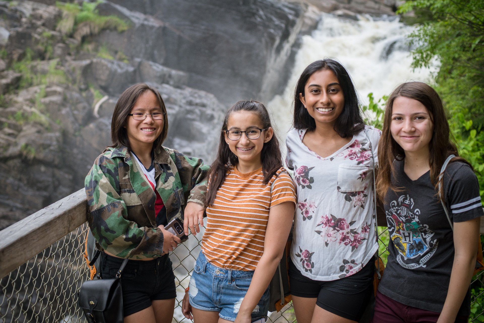 Four girls take a photo at Canyon St-Anne in QC