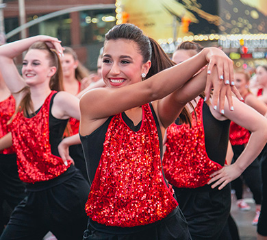 student dancers performing live at Times Square in NYC for Dance The World Broadway