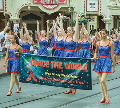 student dancers parading down Main St USA at the Walt Disney World Resort for Dance The World